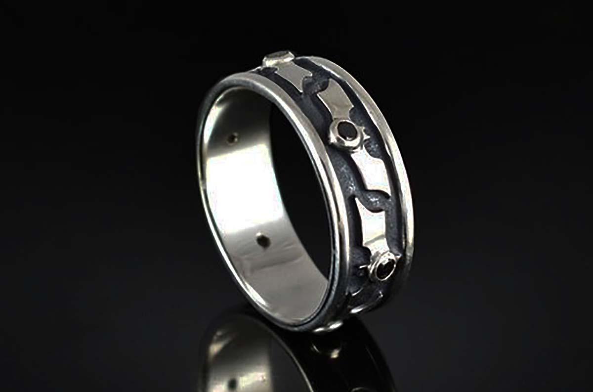 It is an image of Superhero Wedding Rings