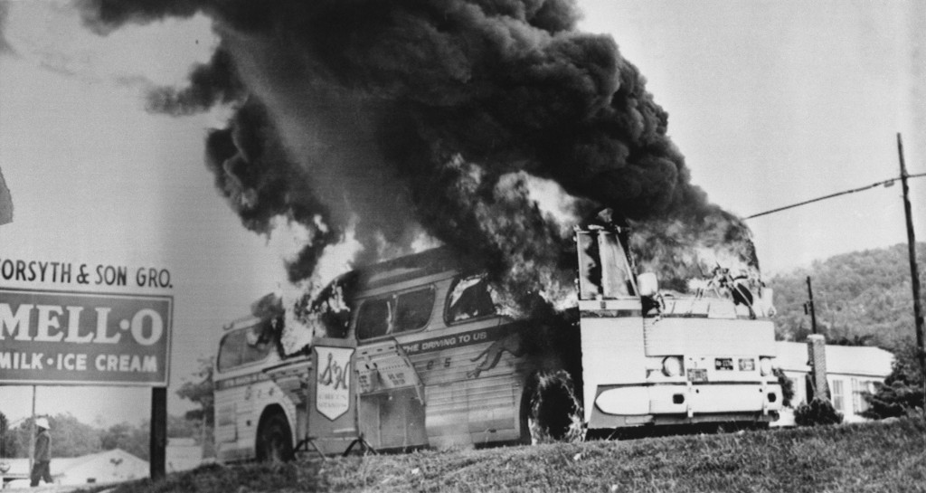 The Freedom Riders bus aflame in Anniston, AL on 15 May 1961 (Mother's Day) after being firebombed by the KKK, who then attempted to block evree fromt he bus and burn the passengers alive, a plan only prevented by an undercover Alabama State Trooper aboard the bus.