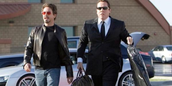 Tony Stark (Robert Downey, Jr.) and Happy Hogan (Jon Favreau) in IRON MAN