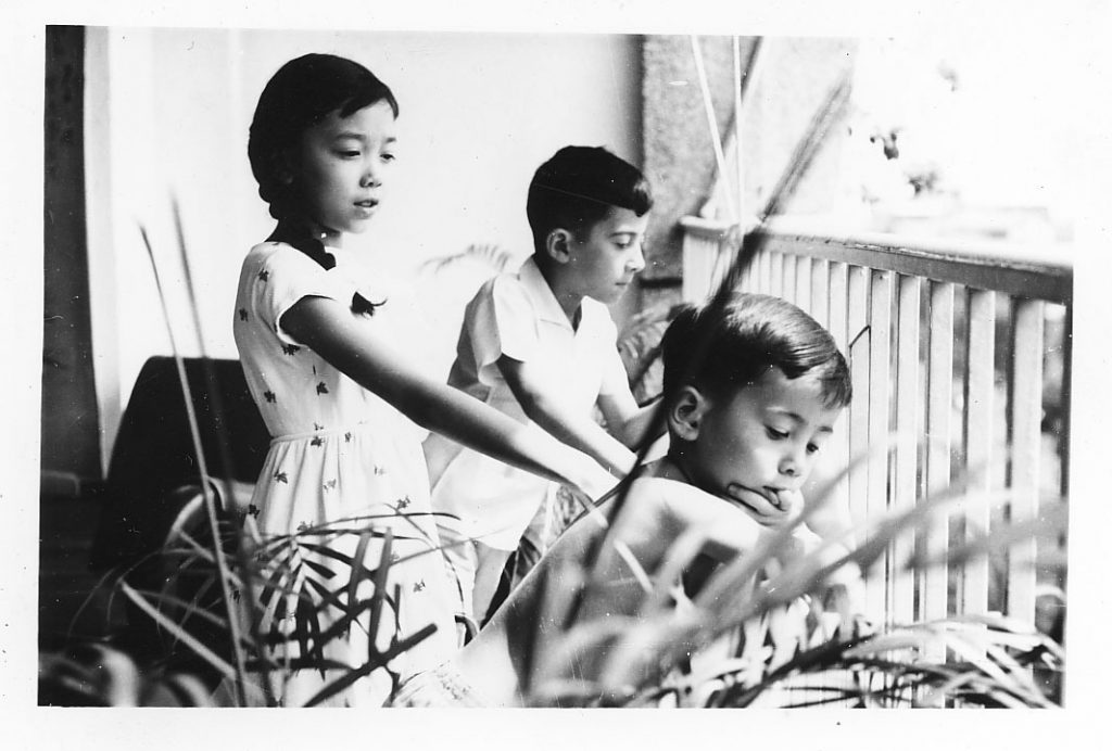 Left to right: Mireille, Dominique, and Marcelino Truong on the balcony of their apartment in Saigon, 1962.